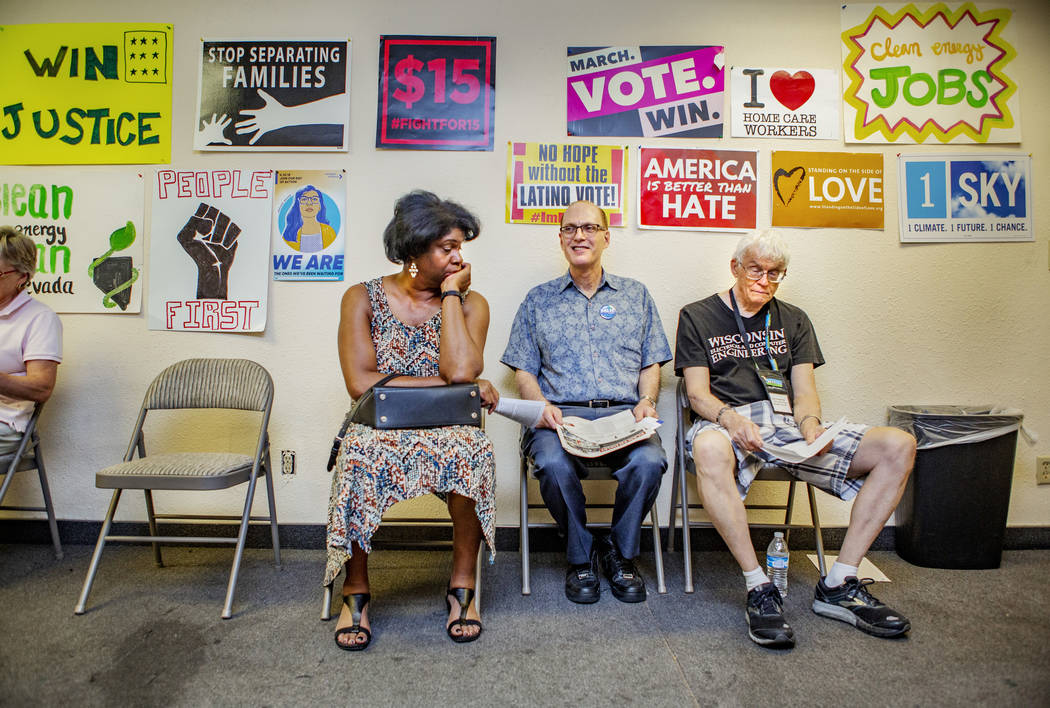 Lorraine Brown, Michael Nussbaum and Gary Vesperman, from Boulder City, sit as they wait for a ...