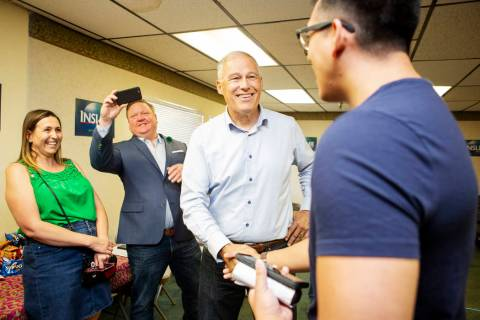Democratic presidential candidate Washington Gov. Jay Inslee, second from right, greets attende ...