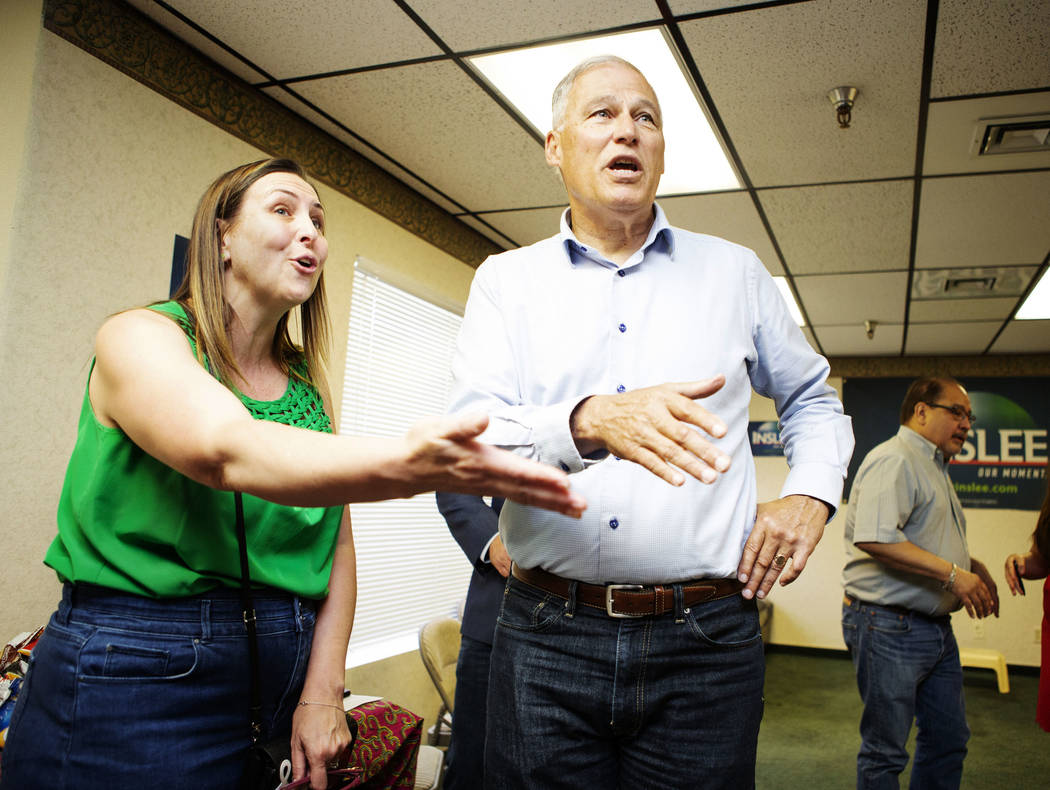 Democratic presidential candidate Washington Gov. Jay Insleegreets attendees with Assemblywom ...
