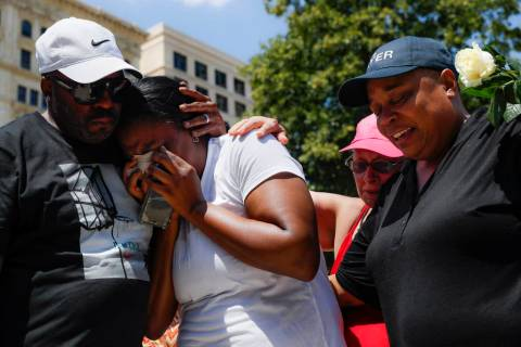 Mourners gather at a vigil following a nearby mass shooting, Sunday, Aug. 4, 2019, in Dayton, O ...