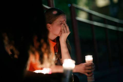 Sherie Gramlich reacts during a vigil for victims of a mass shooting that occurred earlier in t ...