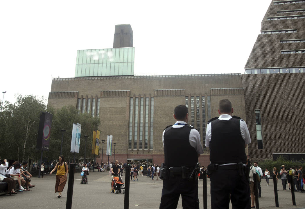 Emergency crews attending a scene at the Tate Modern art gallery, London, Sunday, Aug. 4, 2019. ...