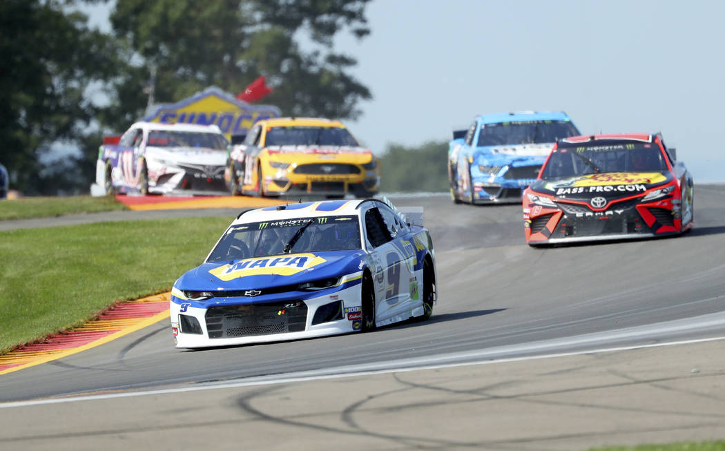 """Chase Elliott leads the field thought the area known as """"The Bus Stop"""" during a NASCA ..."""