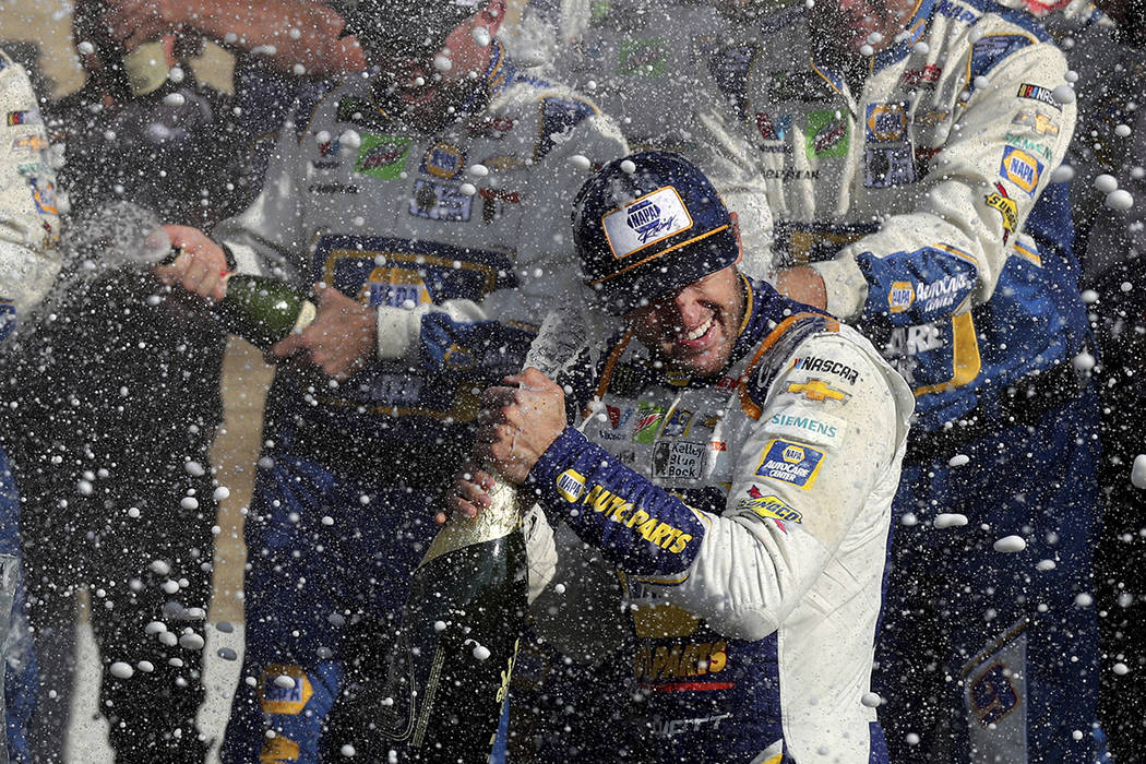 Chase Elliott celebrates his victory with his pit crew after winning a NASCAR Cup Series auto r ...