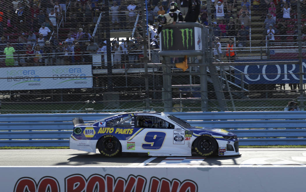 Chase Elliott crosses the finish line to win a NASCAR Cup Series auto race at Watkins Glen Inte ...