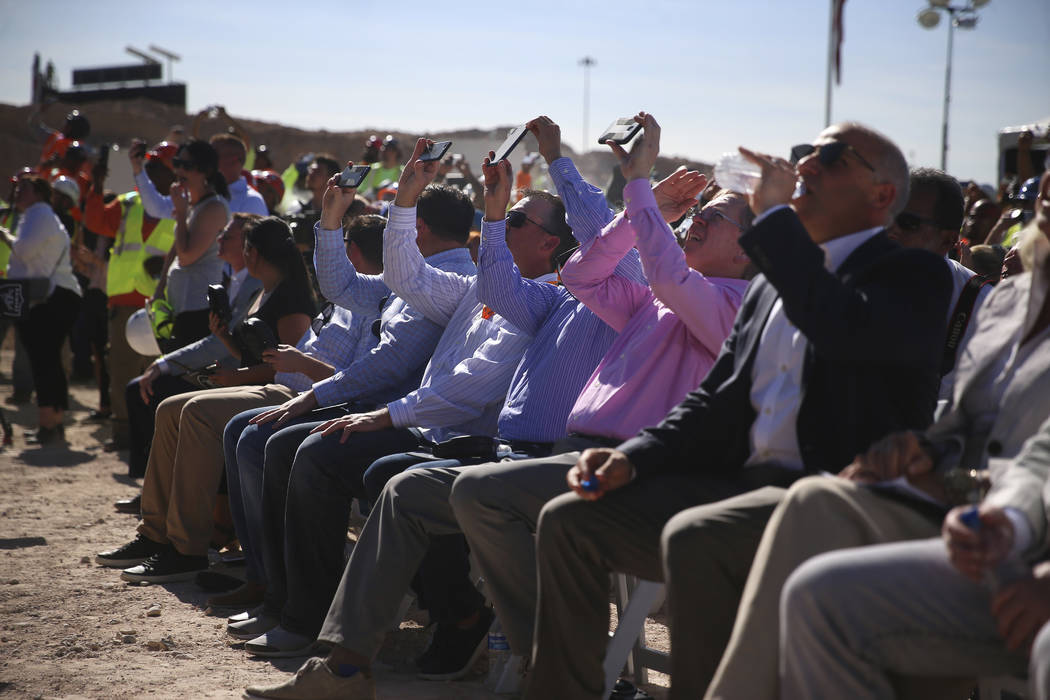 Attendees watch as steel beam is lifted during the Las Vegas Stadium Topping Out Ceremony in La ...
