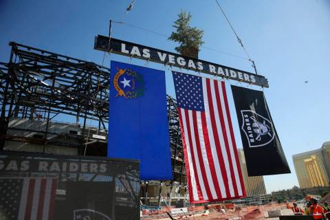A steel beam is lifted during the Las Vegas Stadium Topping Out Ceremony in Las Vegas, Monday, ...