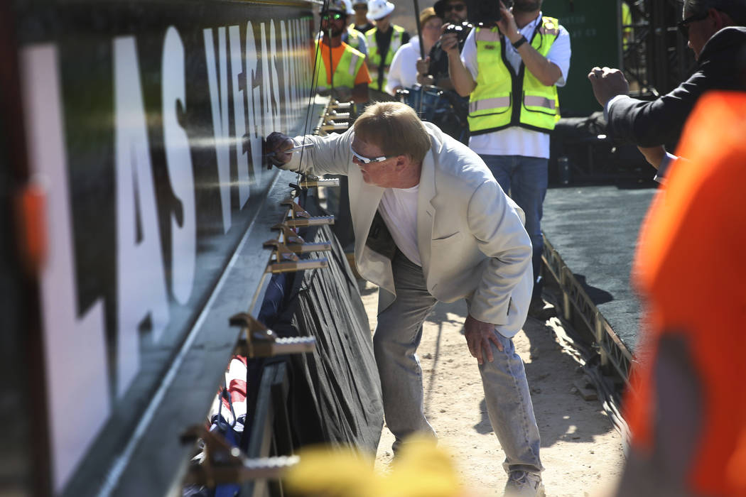 Raiders Owner Mark Davis signs a beam during the Las Vegas Stadium Topping Out Ceremony in Las ...