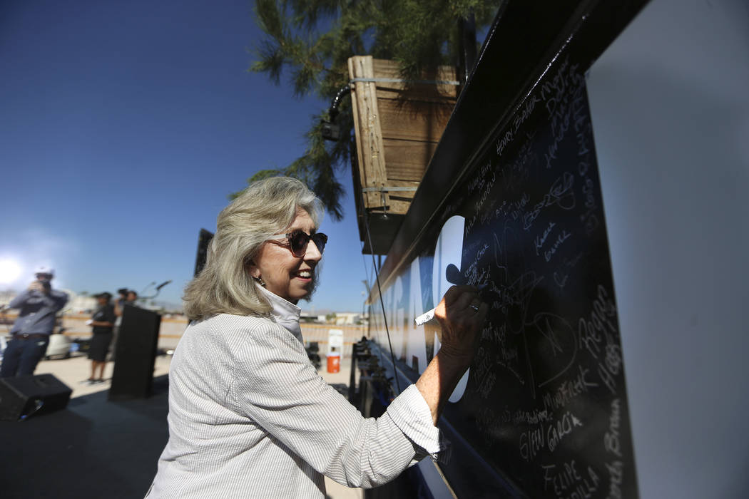 U.S. Rep. Dina Titus, D-Nev., signs a steel beam during the Las Vegas Stadium Topping Out Cerem ...