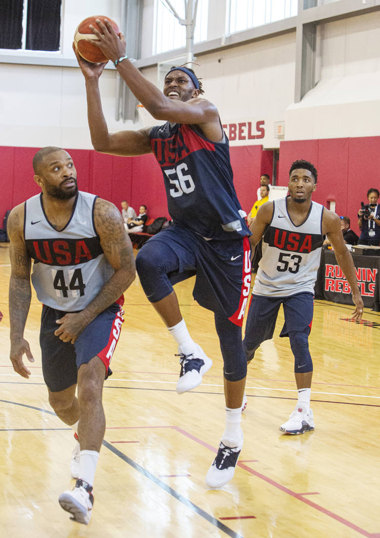 Center Myles Turner (56), of the Indiana Pacers, jumps for a layup against Forward P.J. Tucker ...