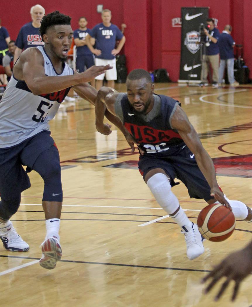 Jarrett Allen (36), of the Brooklyn Nets, dribbles past Donovan Mitchell (53), of Utah Jazz, du ...