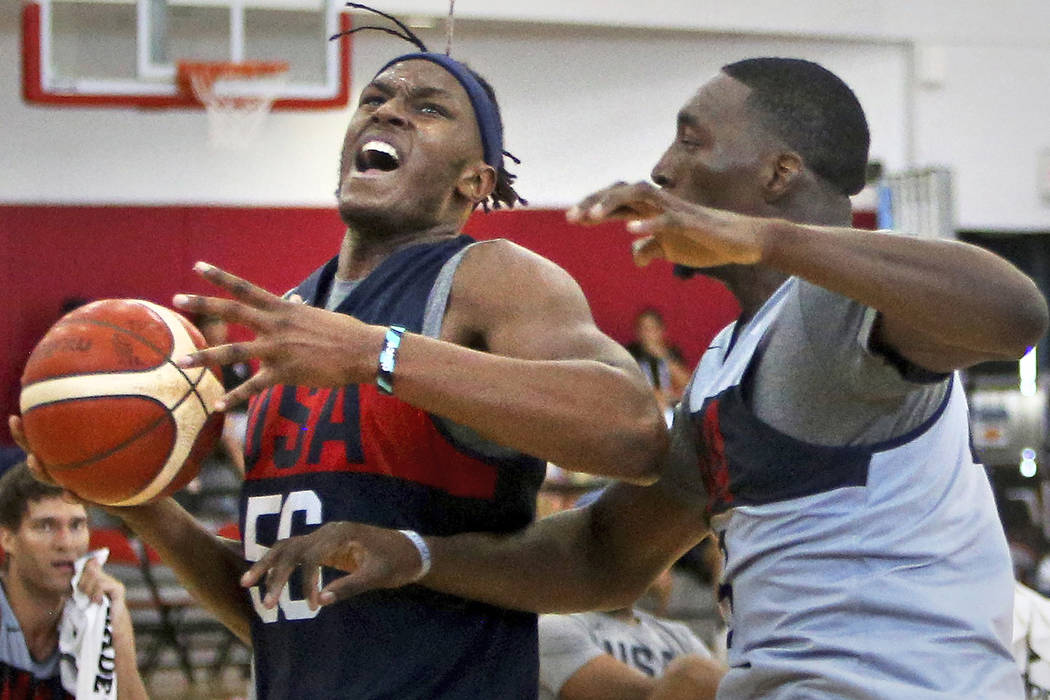 Myles Turner (56), of the Indiana Pacers, pushes past Bam Adebayo (39), of Miami Heat, to attem ...