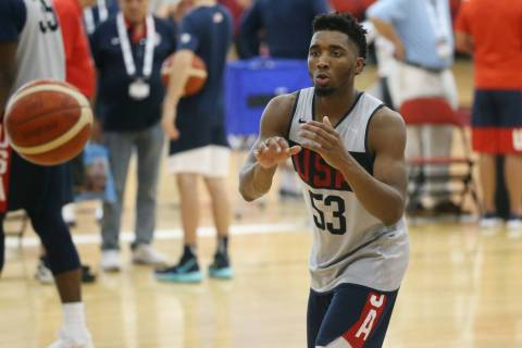 Utah Jazz guard Donovan Mitchell (53) reaches for a pass during the Team USA training camp at U ...