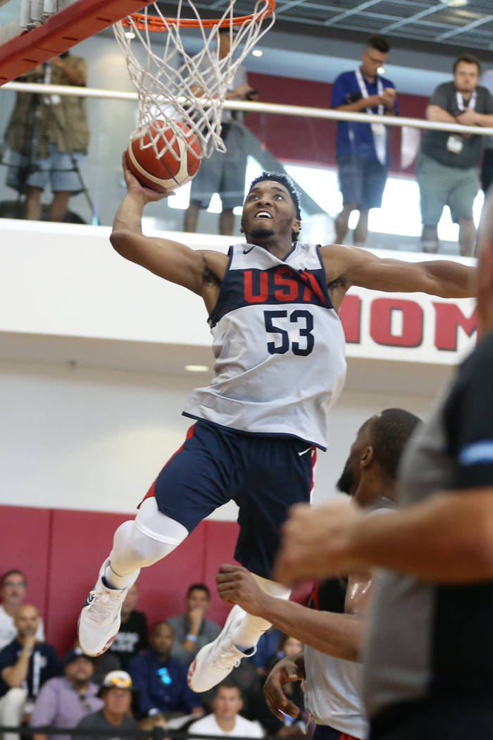 Utah Jazz guard Donovan Mitchell (53) goes up for a dunk during the Team USA training camp at U ...