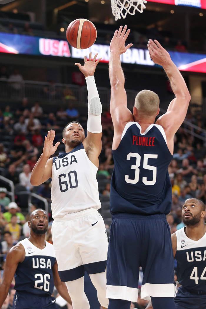 USA Men's National Team White guard Jalen Brunson (60) takes a shot under pressure from USA Men ...