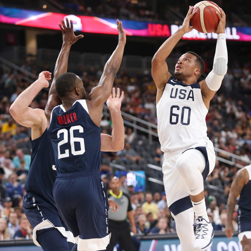 USA Men's National Team White guard Jalen Brunson (60) goes up for a shot under pressure from U ...