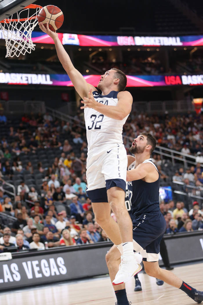 USA Men's National Team White guard Pat Connaughton (32) goes up for a shot against pressure fr ...