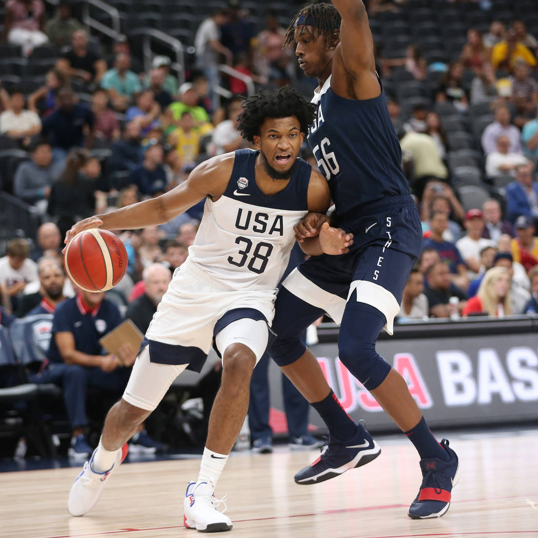USA Men's National Team White forward Marvin Bagley III (38) dribbles the ball under pressure f ...