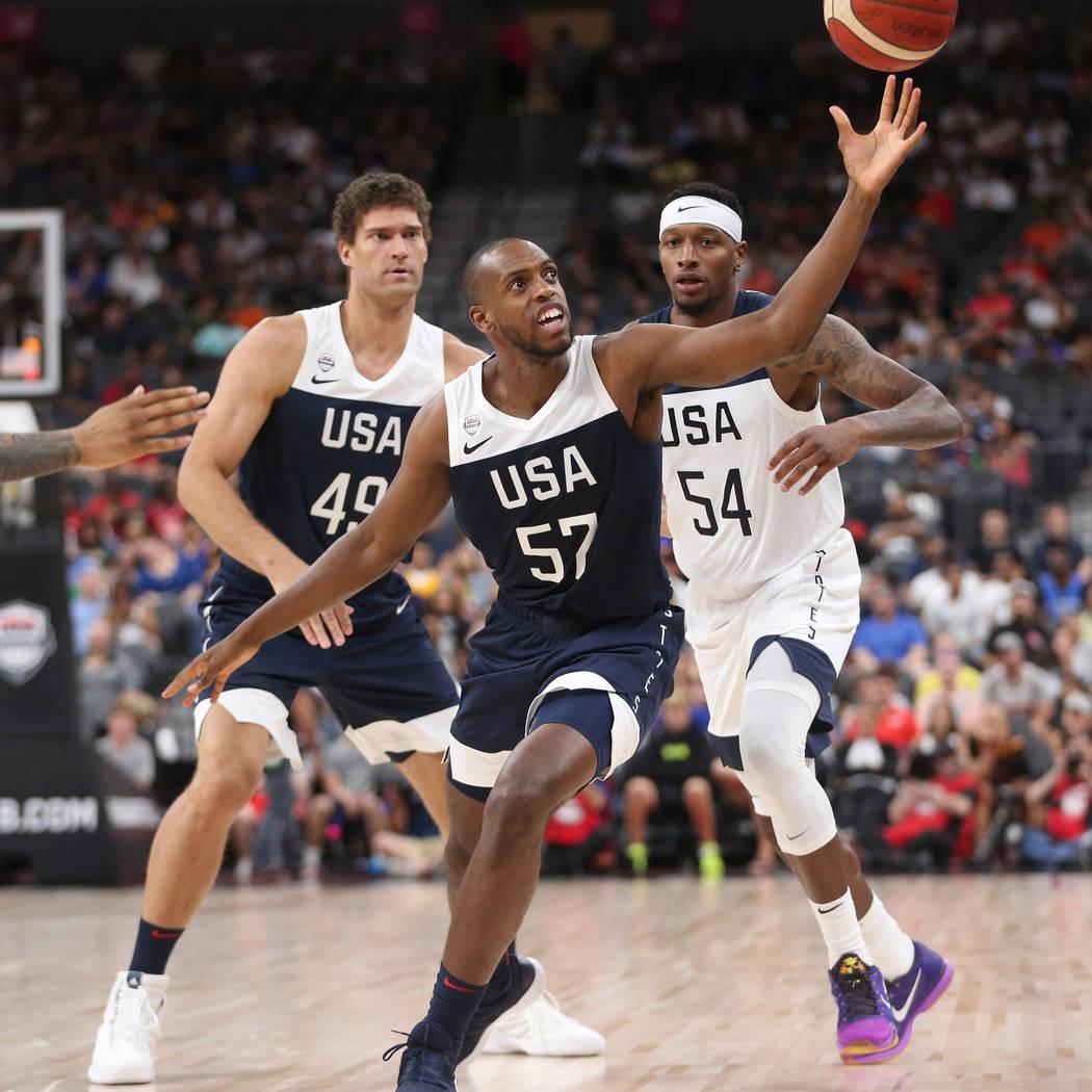 USA Men's National Team Blue forward Khris Middleton (57) reaches for a loose ball as teammate ...