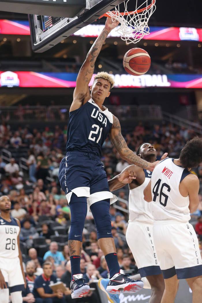 USA Men's National Team Blue forward Kyle Kuzma (21) dunks the ball under pressure from USA Men ...