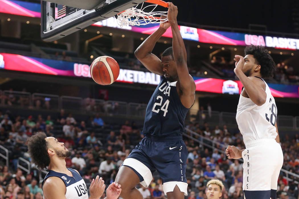 USA Men's National Team Blue Harrison Barnes (24) dunks the ball under pressure from USA Men's ...