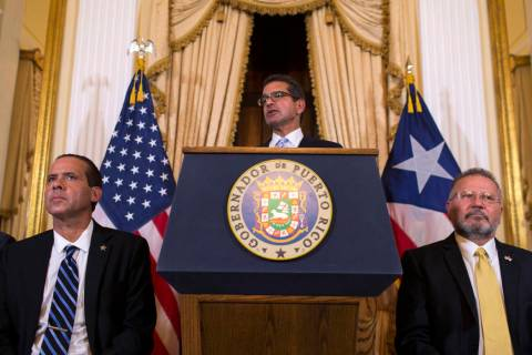 Pedro Pierluisi, sworn in as Puerto Rico's governor, speaks during a press conference, in San J ...