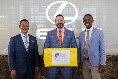 From left, certified sales and leasing consultant Tyron Shigemoto, General Manager Ryon Walters ...