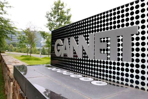 FILE - In this July 14, 2010 file photo, he sign for Gannett headquarters is displayed in McLea ...