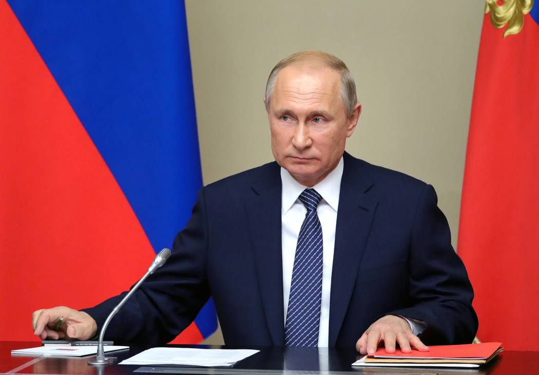 Russian President Vladimir Putin chairs a Security Council meeting in the Kremlin in Moscow, Ru ...