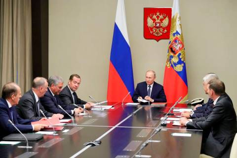 Russian President Vladimir Putin, center, chairs a Security Council meeting in the Kremlin in M ...