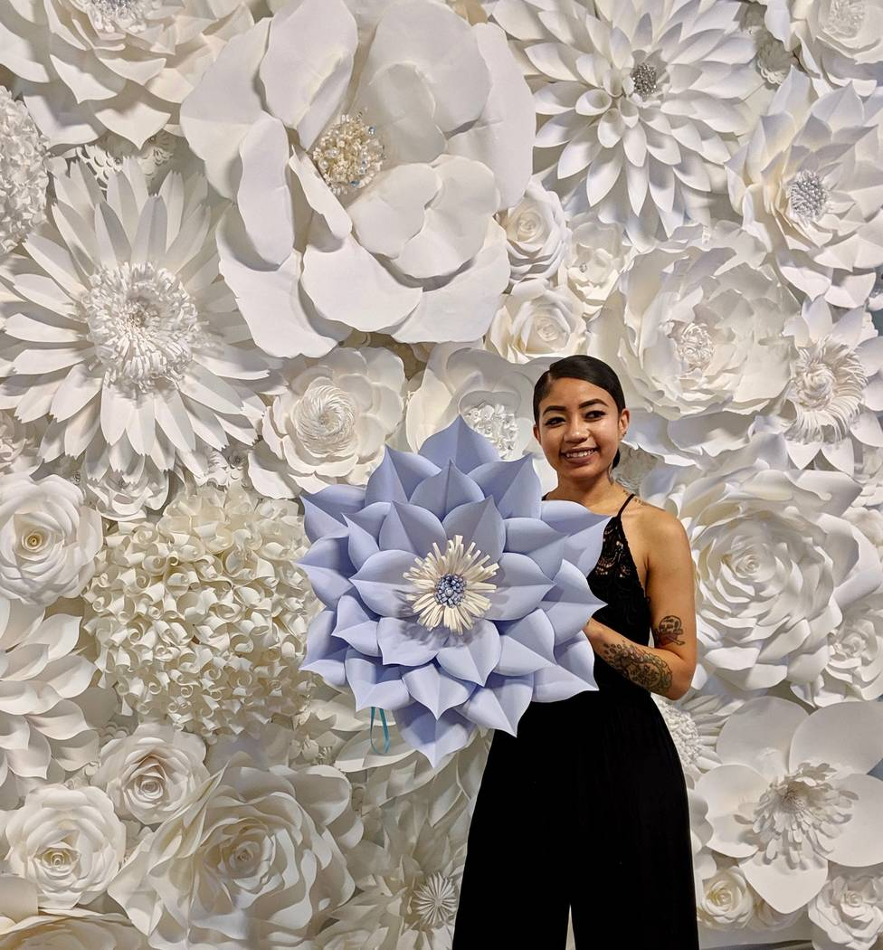 Paper Petals & Wine Daniella Chau poses with a paper flower she made at Paper Petals & Wine.