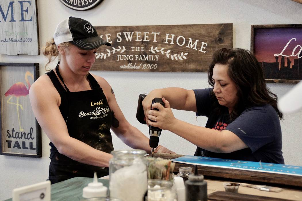 Art Nadler Your Home Lesli Lewis, co-owner of Board & Brush, instructs Rose Sydiongco, right, o ...