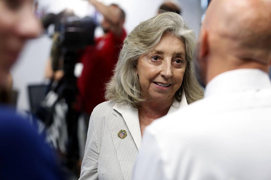U.S. Rep. Dina Titus, D-Nev., speaks with cancer survivor and health care advocate Joe Merlino ...