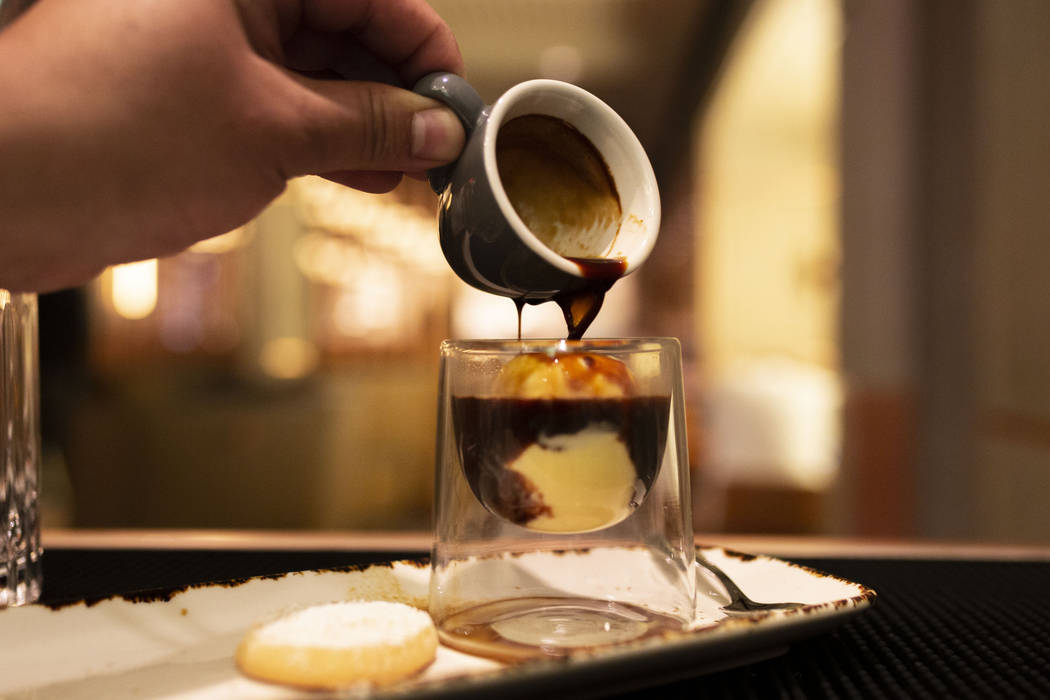 A shot of espresso is poured over the Factory Kitchen's homemade ice cream made for their affog ...