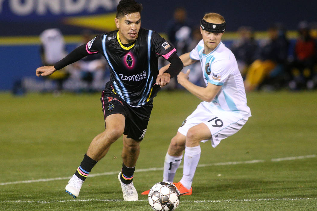Las Vegas Lights FC midfielder Cristhian Hernandez (10) moves with the ball past Austin Bold FC ...