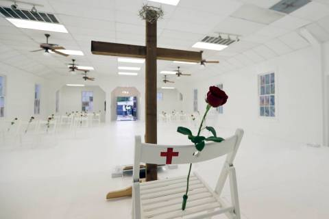 In a Nov. 12, 2017, file photo, a rose rests on a chair during a memorial for the victims of th ...