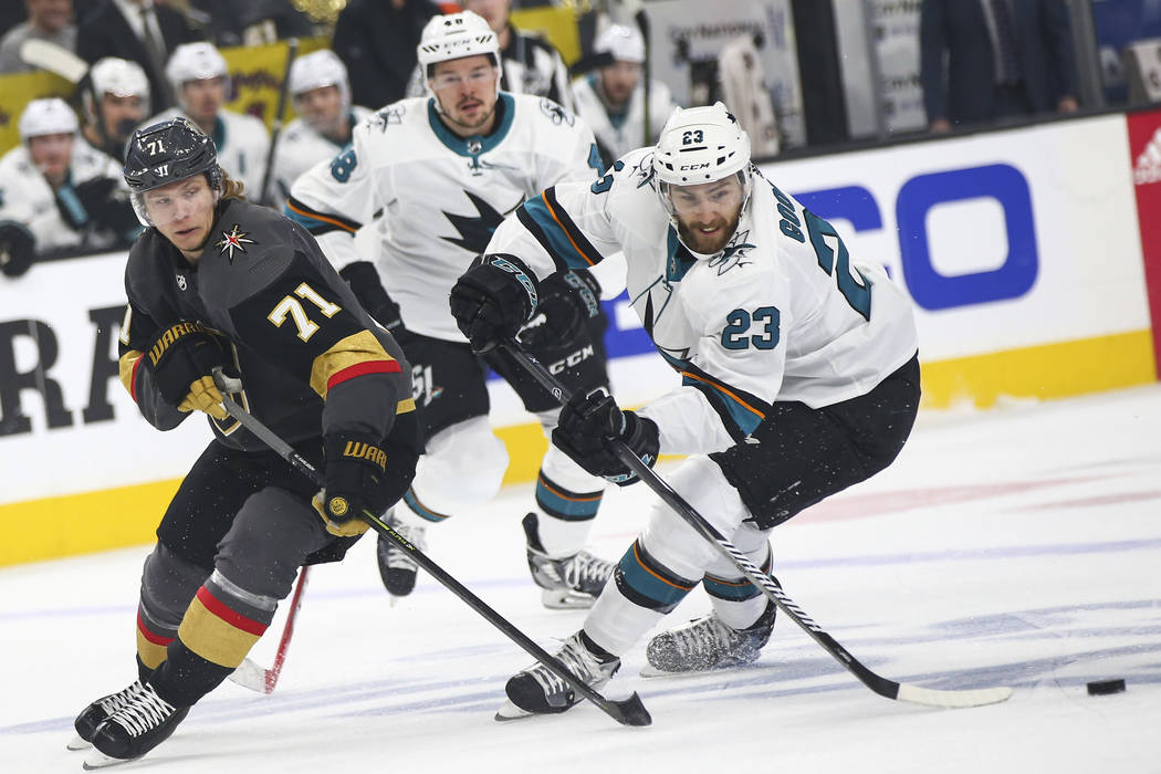 San Jose Sharks right wing Barclay Goodrow (23) skates with the puck under pressure from Golden ...