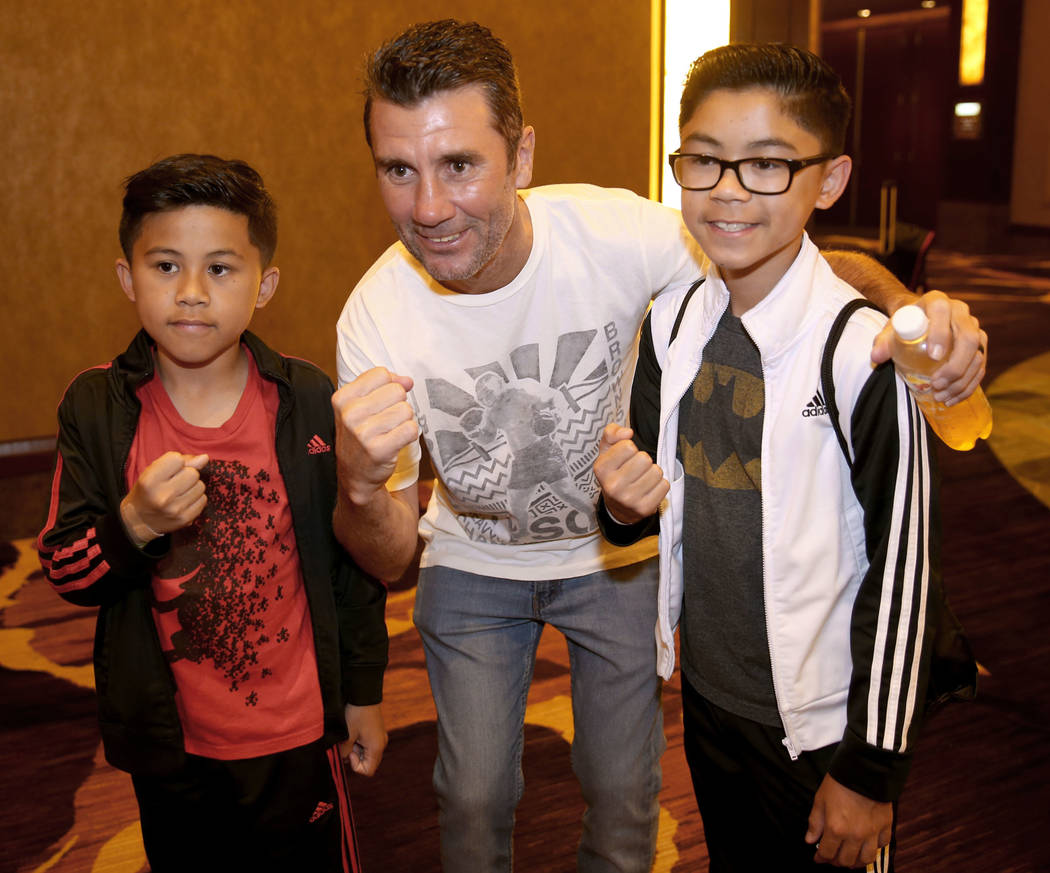 Nevada Boxing Hall of Fame inductee Wayne McCullough visits with fans Ethan Cal, 12, and Reagan ...