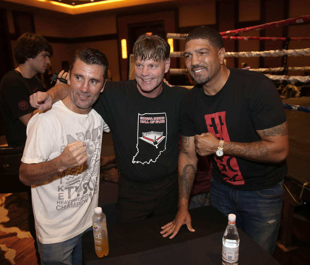"Nevada Boxing Hall of Fame inductee Wayne McCullough, left, visits fellow inductee Ronald "" Wi ..."