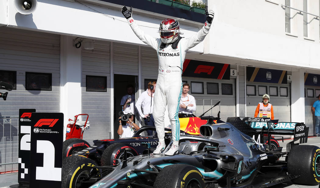 Mercedes driver Lewis Hamilton of Britain celebrates after winning the Hungarian Formula One Gr ...