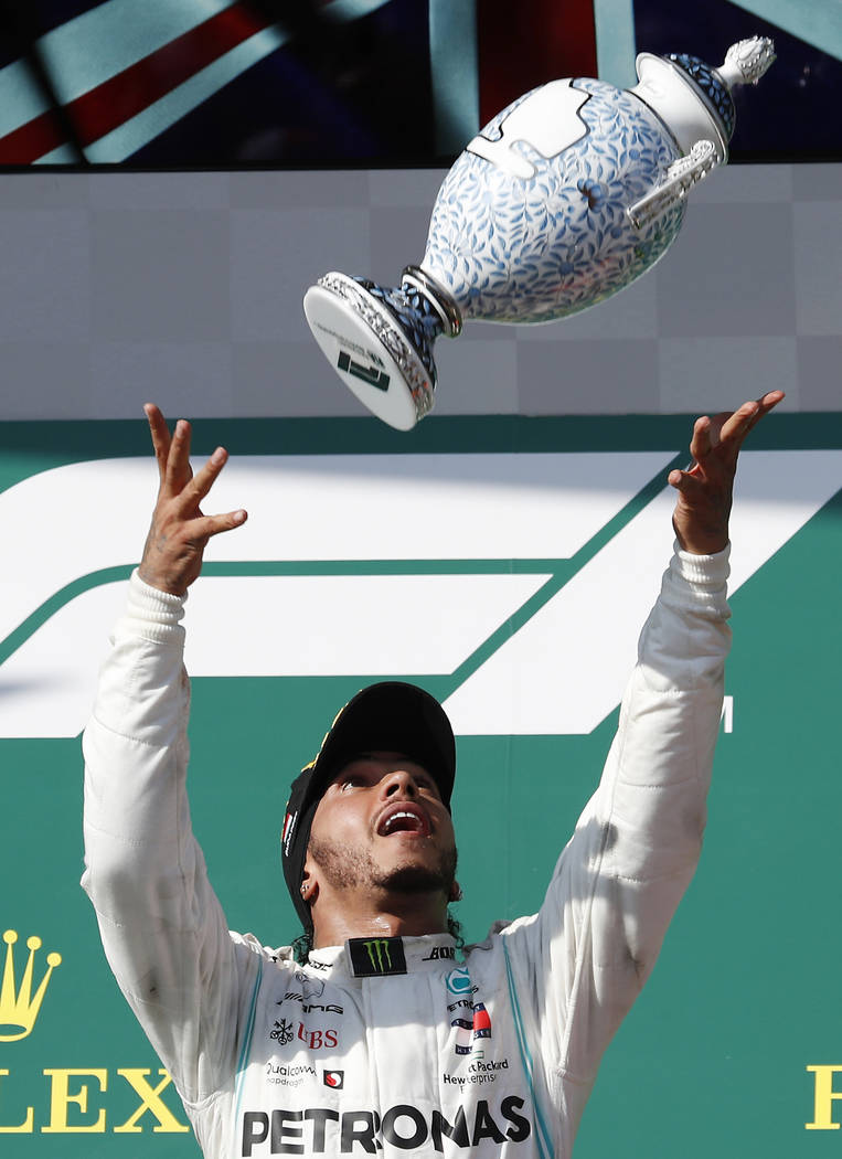 Mercedes driver Lewis Hamilton of Britain celebrates on the podium after winning the Hungarian ...