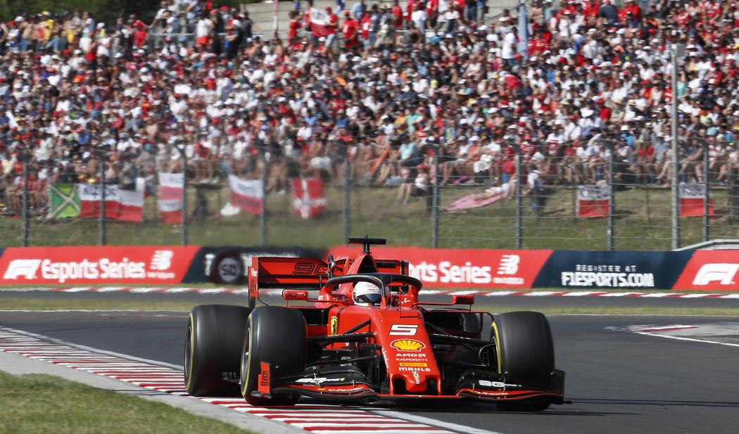 Ferrari driver Sebastian Vettel of Germany steers his car during the Hungarian Formula One Gran ...