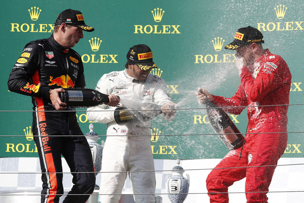 Mercedes driver Lewis Hamilton, center, of Britain, winner of the Hungarian Formula One Grand P ...