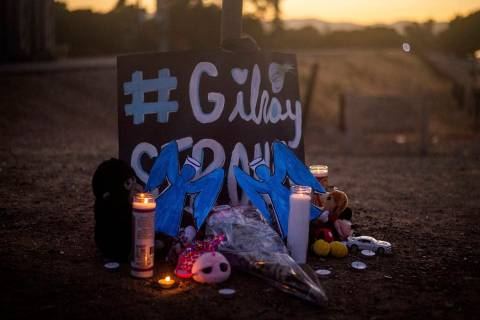 Candles burn at a makeshift memorial for Gilroy Garlic Festival shooting victims outside the fe ...