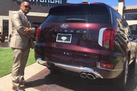 Hyundai of Las Vegas executive Eddie Matias is seen with the 2020 Hyundai Palisade sport utilit ...