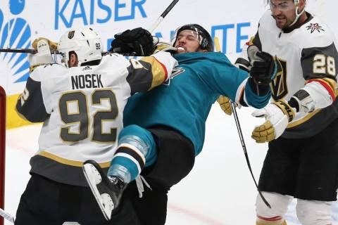 Knights left wing Tomas Nosek (92) punches Sharks defenseman Brenden Dillon (4) in the second p ...