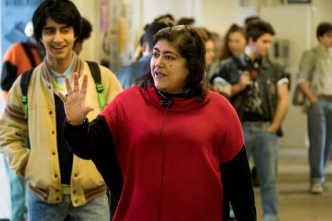 "Viveik Kalra, left, and director Gurinder Chadha on the set of ""Blinded by the Light."" (Nick W ..."