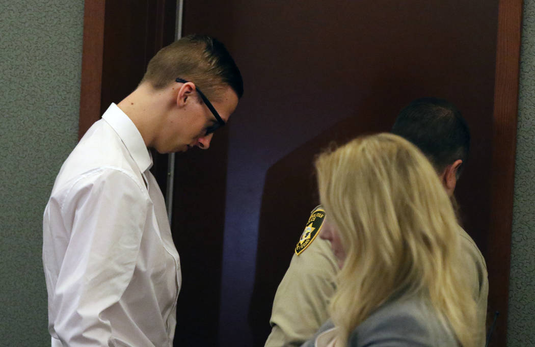 Kody Harlan, 17, is led out of the courtroom at the Regional Justice Center on Wednesday, July ...