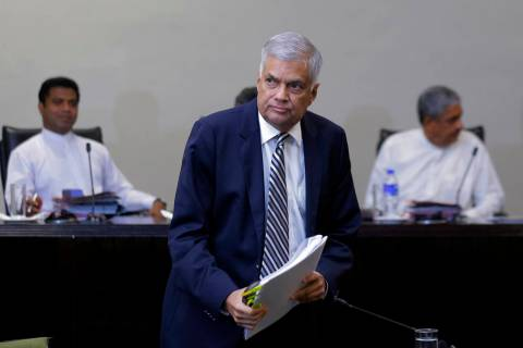 Sri Lankan Prime Minister Ranil Wickremesinghe leaves after testifying in front of a parliament ...