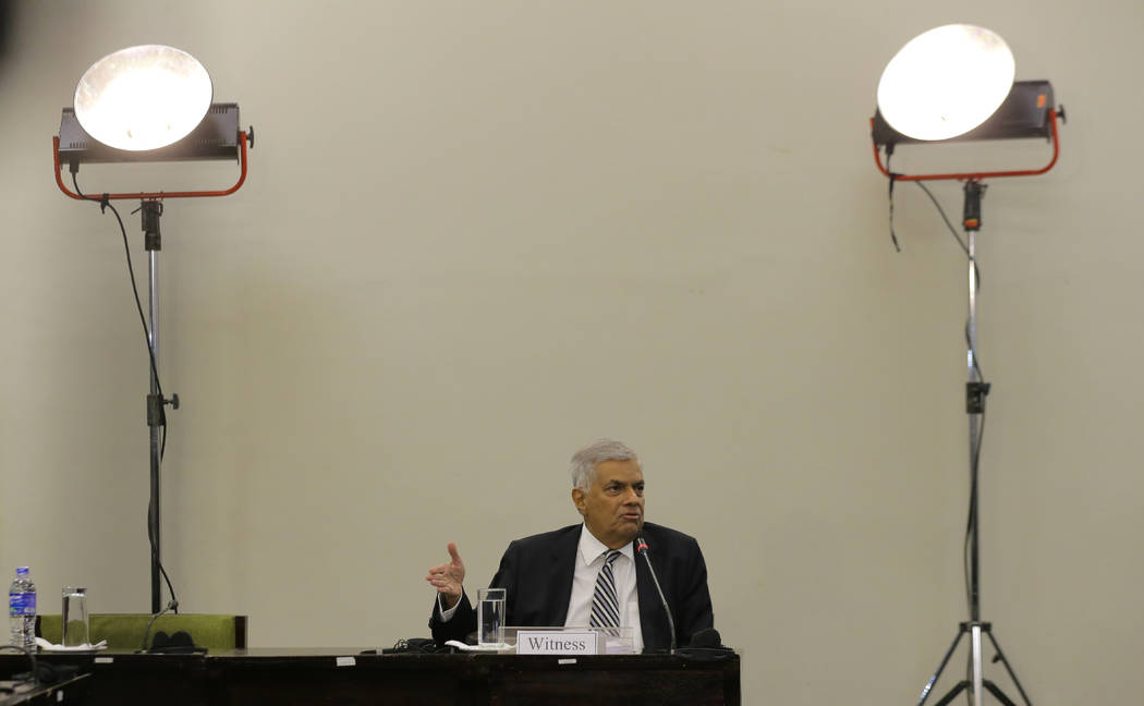 Sri Lankan Prime Minister Ranil Wickremesinghe testifies in front of a parliamentary committee ...